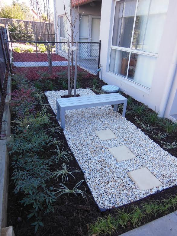 White bench garden feature